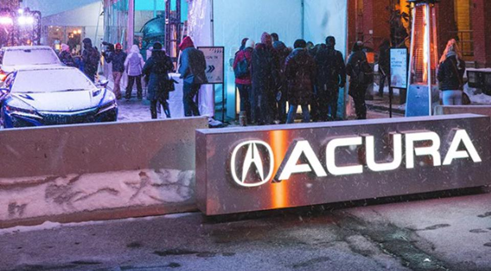 Acura village contains Acura brand vehicles, charging stations, event stage, refreshments.