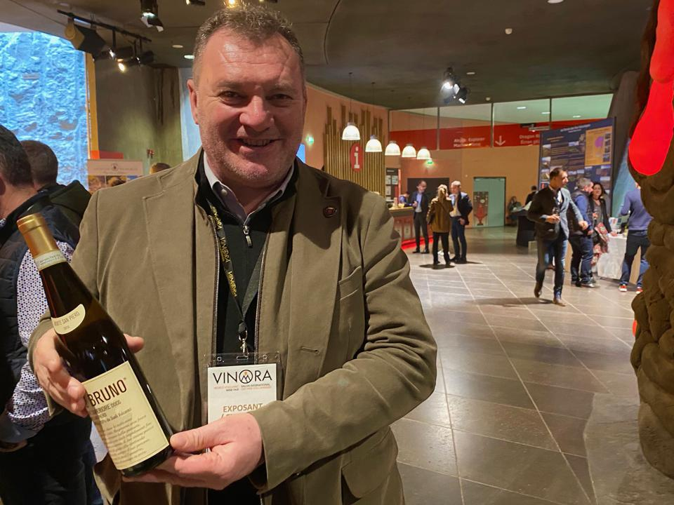 Sandro Tasoniero with Soave wine
