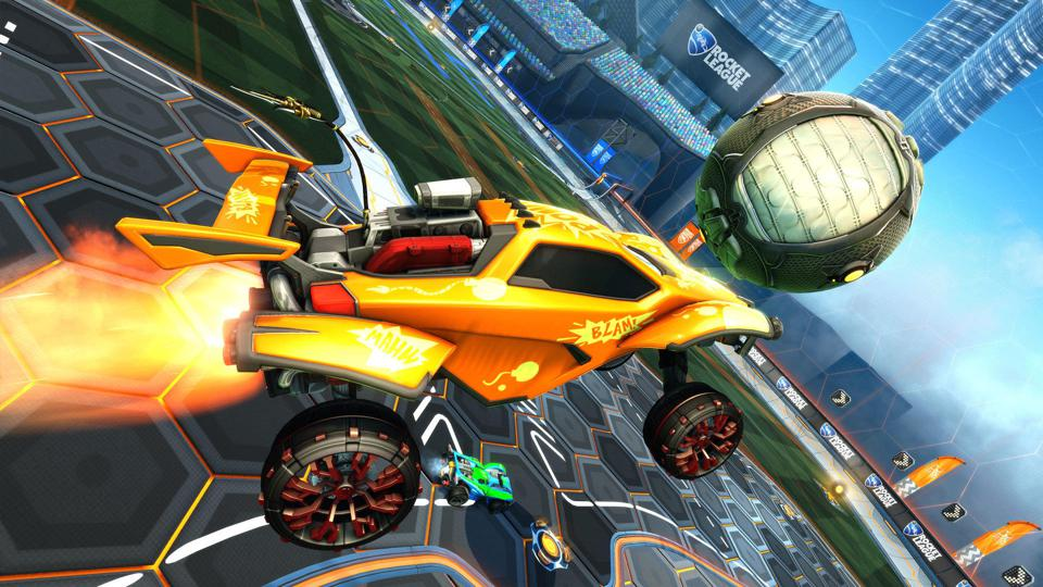 A 'Rocket League' car hits the ball.
