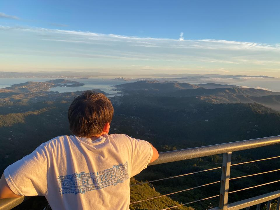 boy looking out over the horizon from Mt Tam