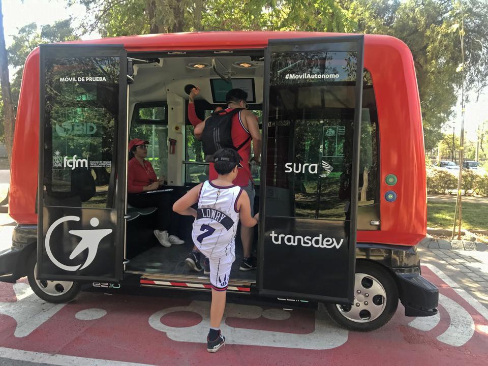 A commuter boards an EZ10 in the Transdev pilot project in Santiago de Chile.