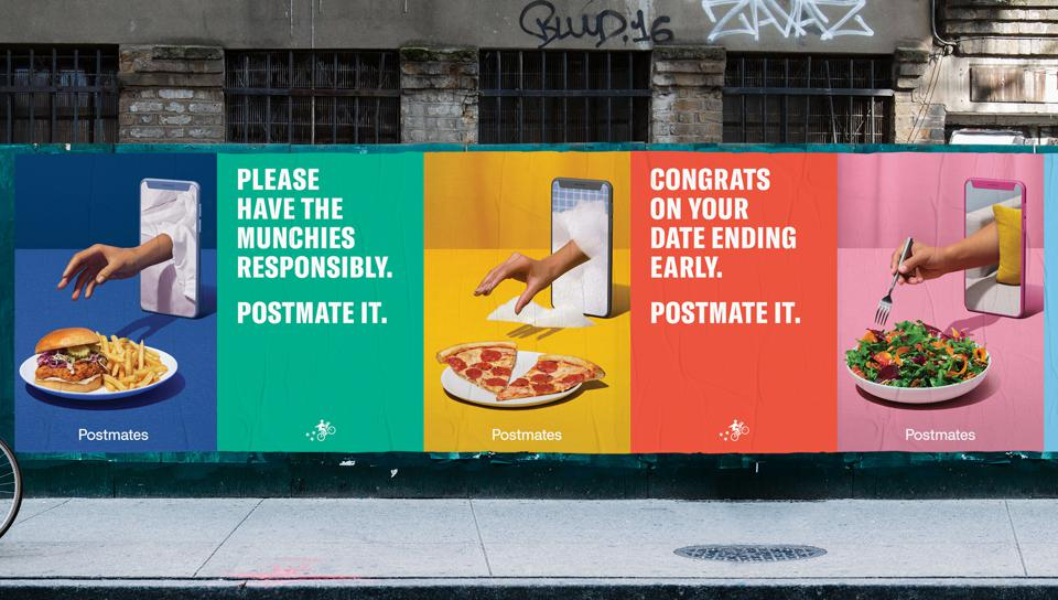 An out-of-home ad that is part of Postmates' newest campaign, launched during the Oscars.