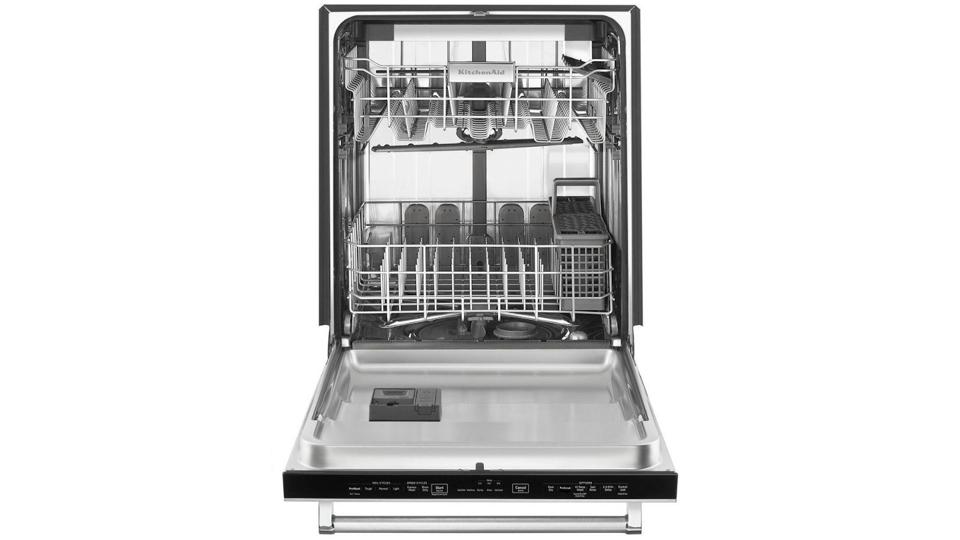 Stainless Steel open KitchenAid dishwasher on a white background.