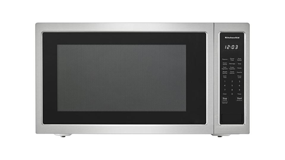 Stainless steel KitchenAid microwave on a white background.
