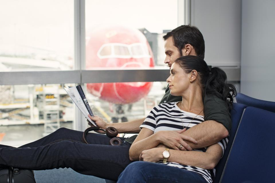 Couple waits for Norwegian Airlines flight