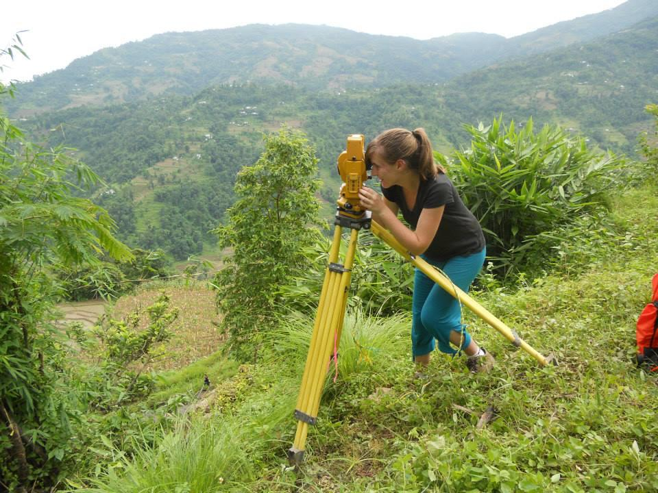 Bryne, in Nepal, surveying with Engineers Without Borders.