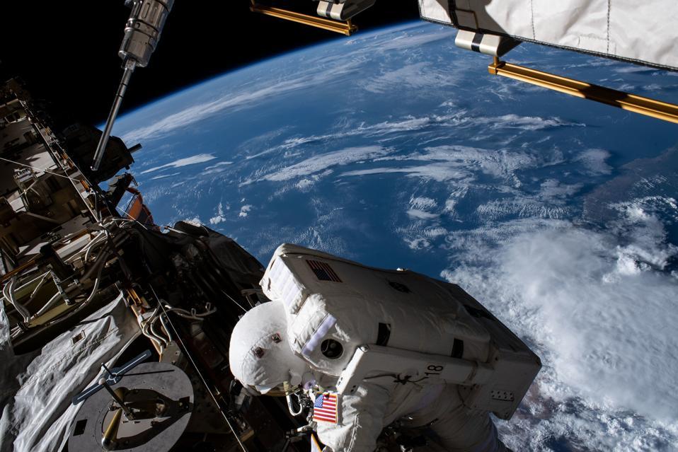 Spacewalker Christina Koch works 256 miles above the Atlantic Ocean