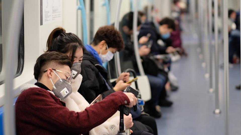 People preparing for Coronavirus, wearing masks.