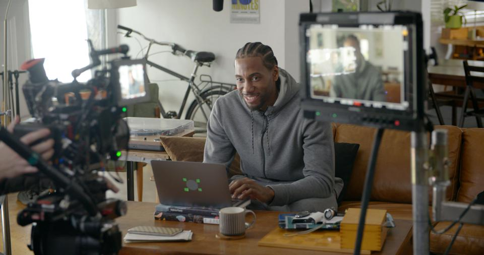 Kawhi Leonard behind-the-scenes during his newest Honey commercial.
