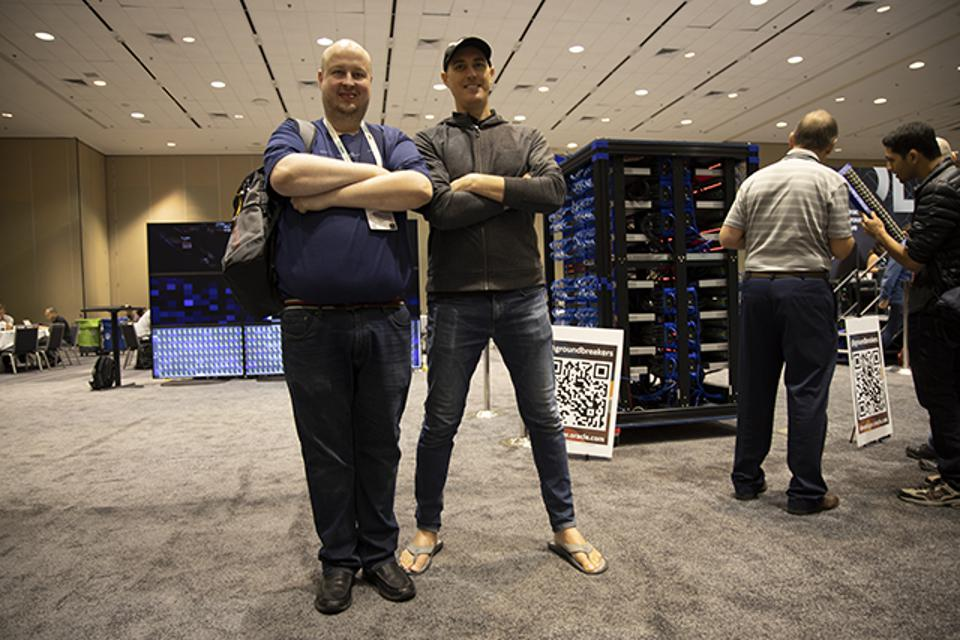 "Jasper Potts, left, a ""resident inventor"" and IoT engineer at Oracle, and Chris Bensen, an Oracle Experience Engineer and Java developer, stand proudly in front of their creation."