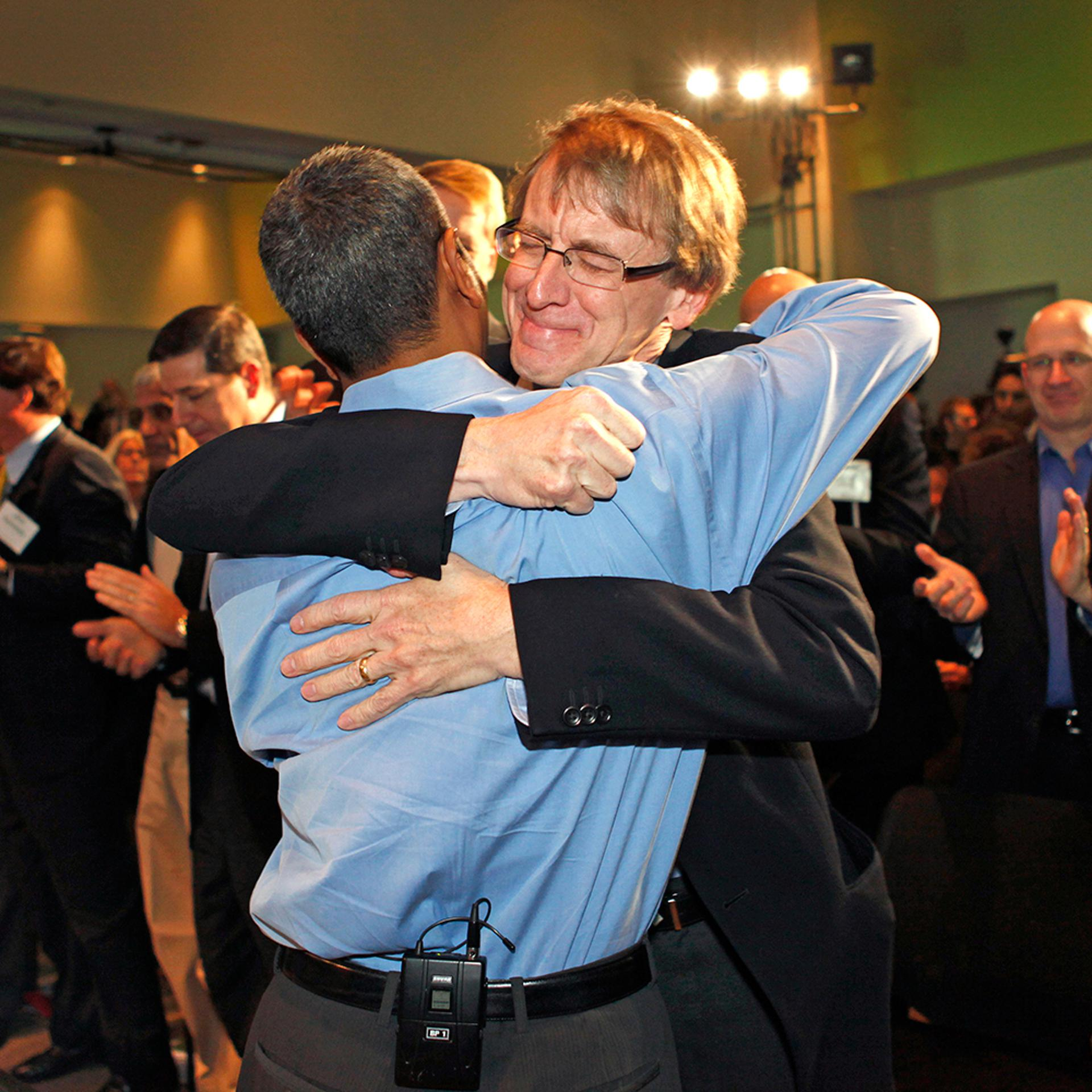 Bloom-secondary-3-John-Doer-embraces-KR-Sridhar-by-Kim-Kulish-Corbis-Getty-Images