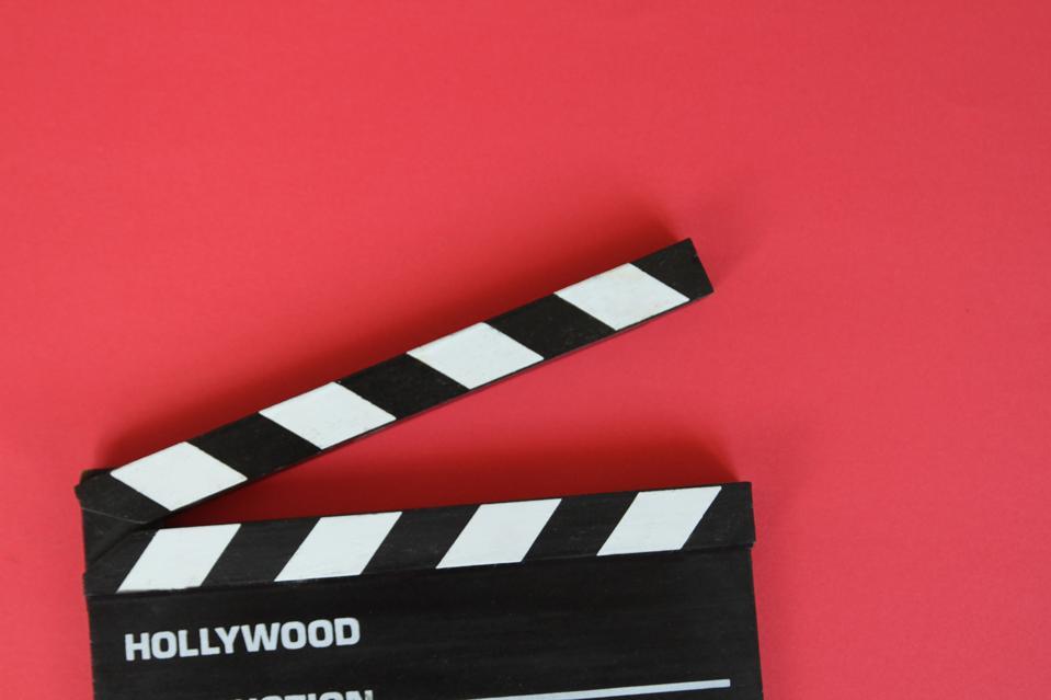 Filmmaker's Clapboard On Red Background. Cinema Concept.