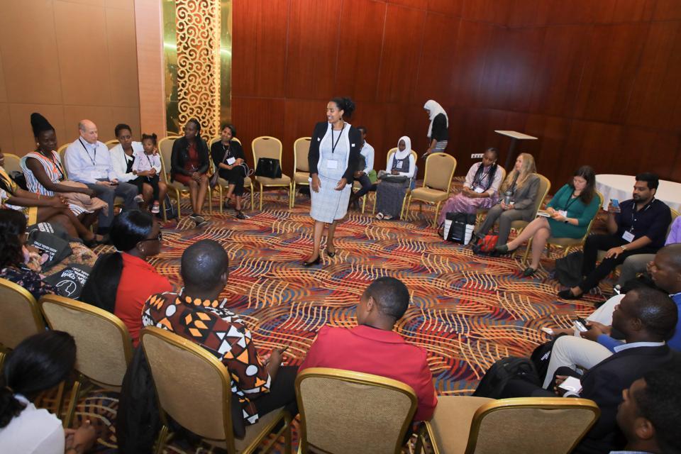 Yetnebersh Nigussie conducting a program on youth leadership at the forum.