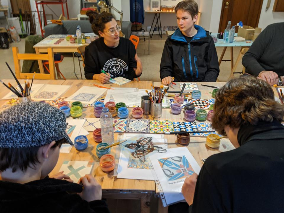 Marisa Ferreira explains how to use a stencil to paint an Azulejo. The tiles are then fired in a kiln at 1,886 degrees (F) for 20 hours.