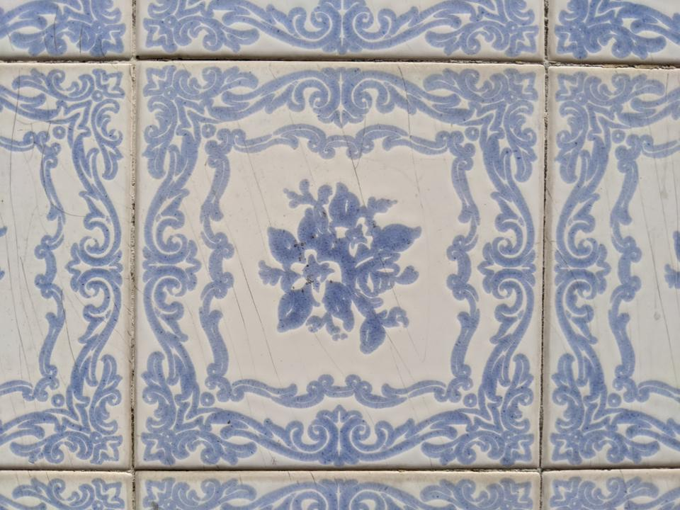 Azulejo tiles on the side of a residence in Porto's Santo Ildefonso neighborhood. Despite a law protecting the tiled facades, many are disappearing.