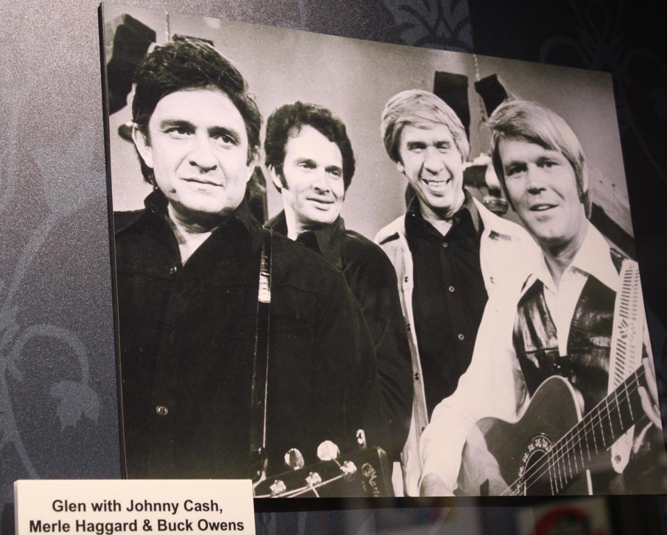 Photo of Johnny Cash, Merle Haggard, Buck Owens, and Glen Campbell on display at the Glen Campbell Museum
