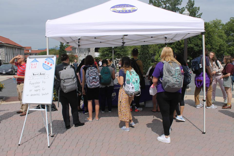 Students at the JMU Center for Civic Engagement offer information on the Census.