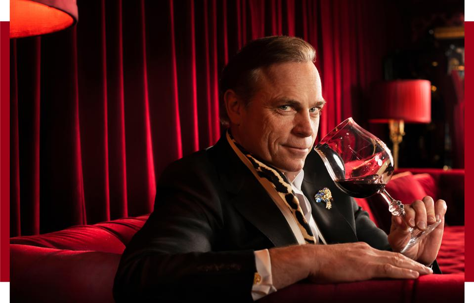 Jean-Charles Boisset, in the Raymond Vineyards' Red Room, has a boutique that sells his jewelry—and a bobblehead of himself.