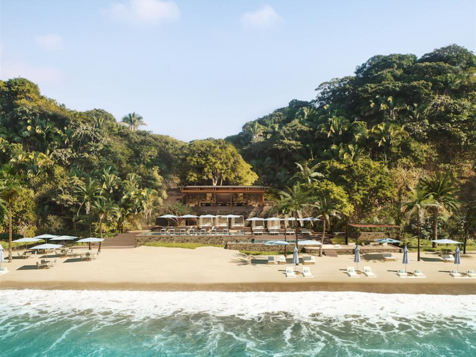 Canalan Beach is framed by a jungle backdrop and sea.