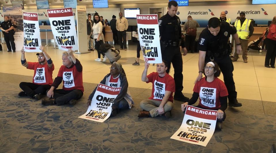 Demonstrators get arrested at Charlotte Douglas International Airport on Friday Feb. 14