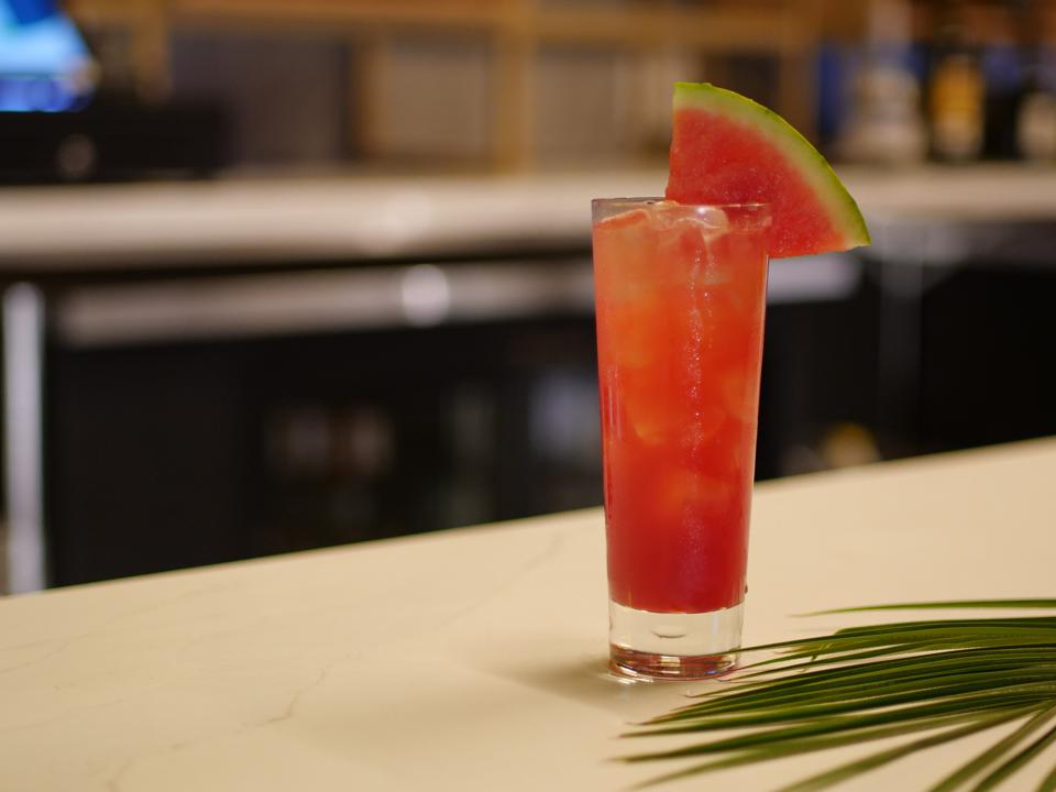 Cocktail garnished with watermelon slice.
