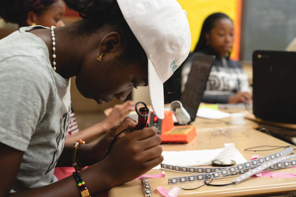 girl soldering at STEM From Dance GIrls Rise Up summer camp.