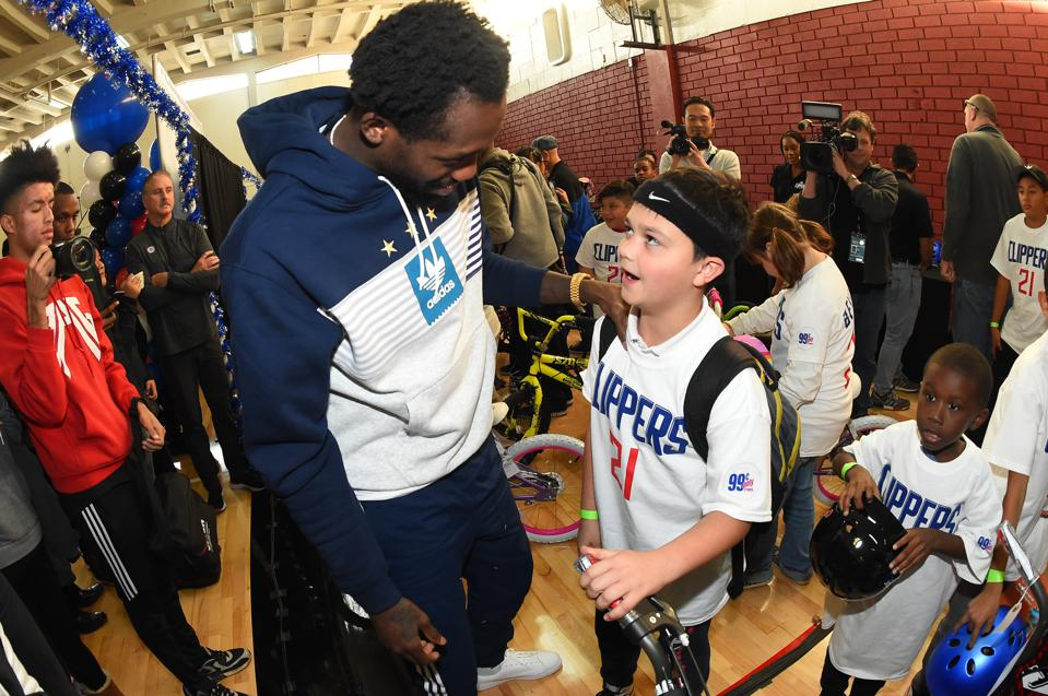 Patrick Beverley of the Clippers gives away bicycles to kids at the YMCA in Van Nuys, Calif. in December 2019.