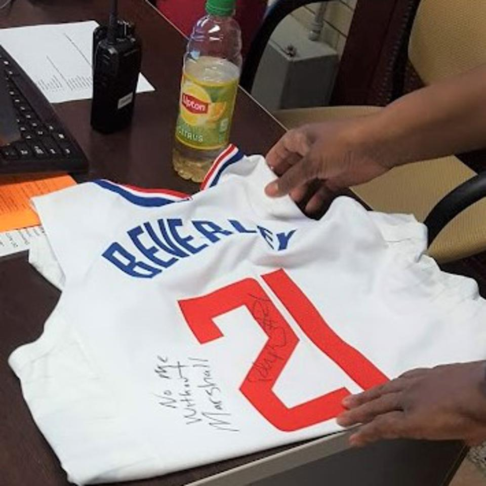 At Marshall High in Chicago, Patrick Beverley autographed a Clippers jersey, reading, ″No Me Without Marshall.″ Beverley is a point guard for the L.A. Clippers.