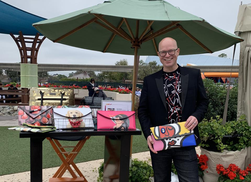 Kent Stetson displaying his handbags at a festival market