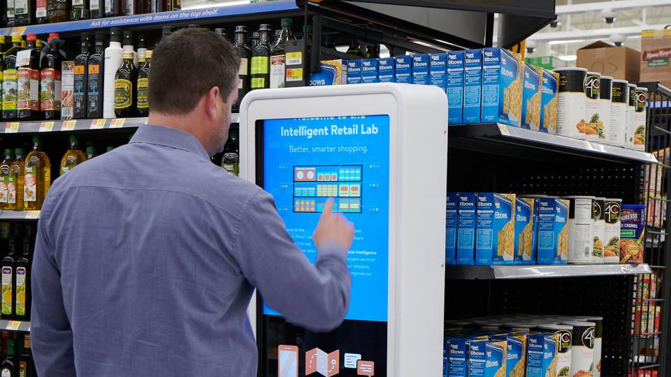 This photo shows a shopper exploring information about what's happening in the store.