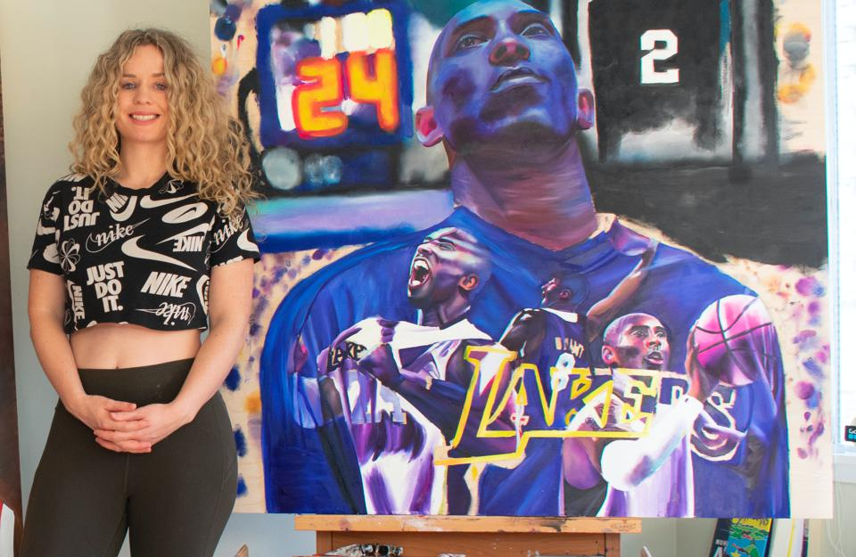 Canadian artist Carling Jackson in front of her paintings the late Kobe Bryant, February 2020