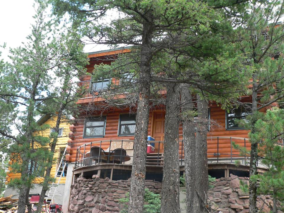 Log cabin style lodging at Fortitude Ranch