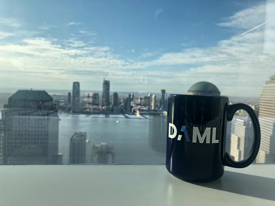 A DAML branded mug atop a windowsill in Digital Asset's downtown office.