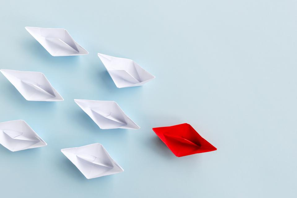 Red Paper Boat Followed by White Paper