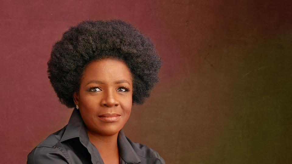 A portrait of a black woman with natural hair