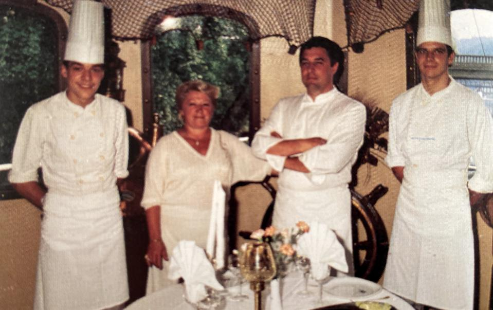 Bruno Bertin, age 18, with his parents and brother at his family's restaurant.