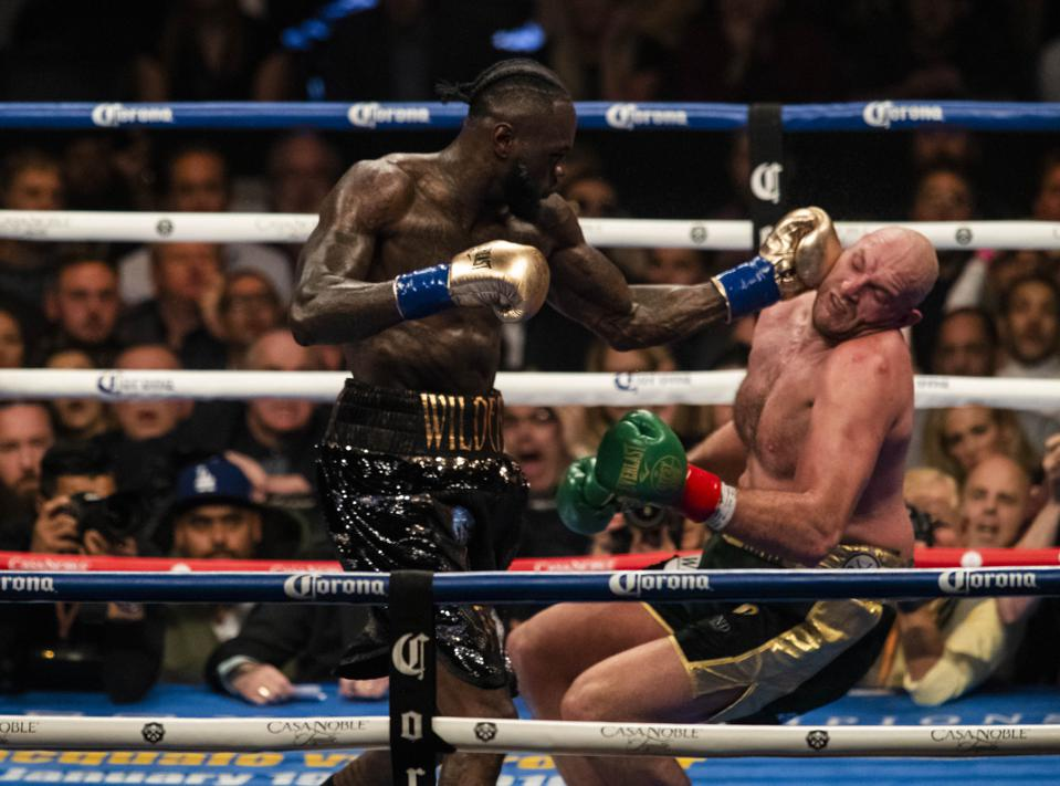Deontay Wilder vs Tyson Fury odds records purses prediction