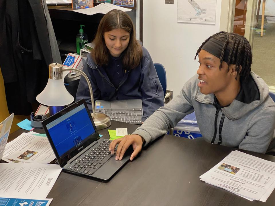 WLA student showing a website he built