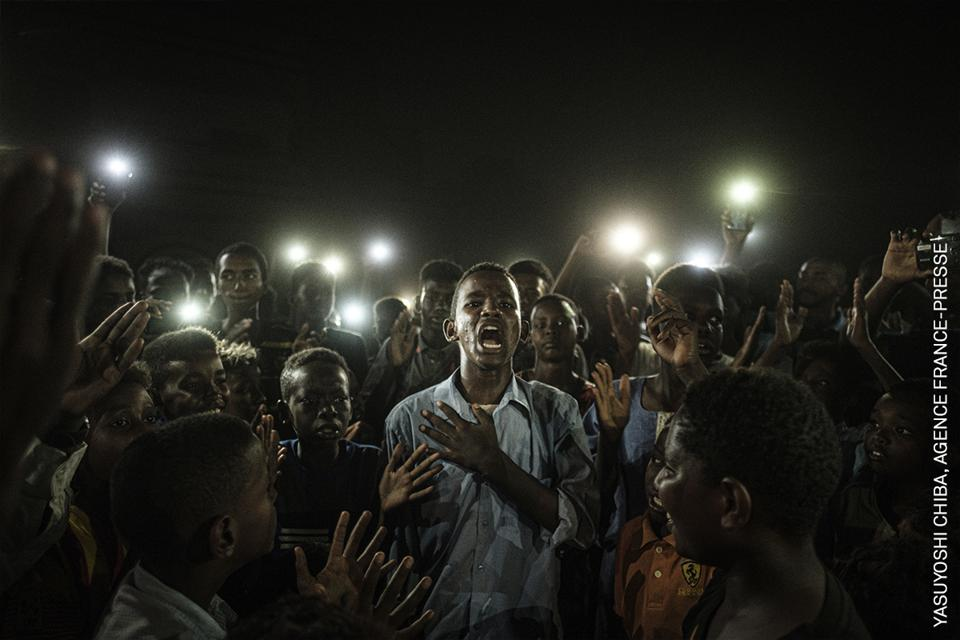 Protesters in Sudan illuminated by mobile phones