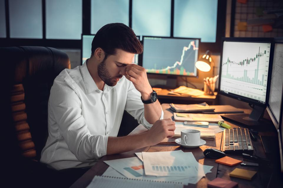 Depressed frustrated cryptocurrency trader trying to understand IRS tax policy