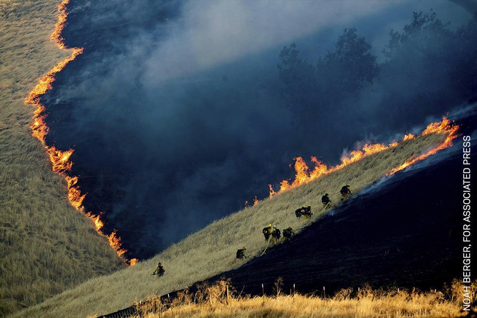 Firefighters battling California fires