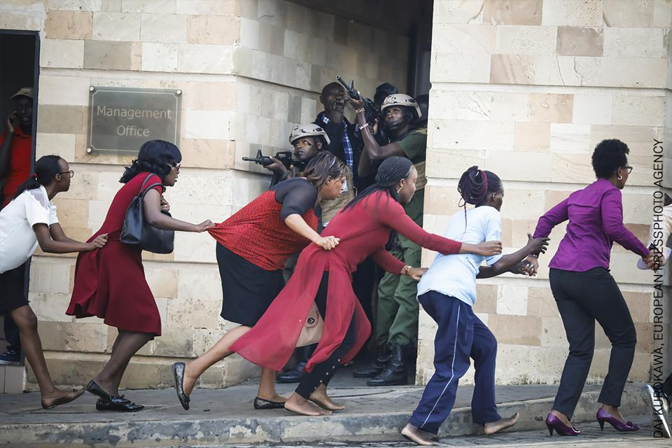 women being evacuated after terrorist attack