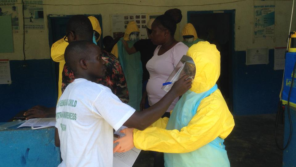Health workers in Liberia practice wearing personal protective equipment during the West African Ebola epidemic