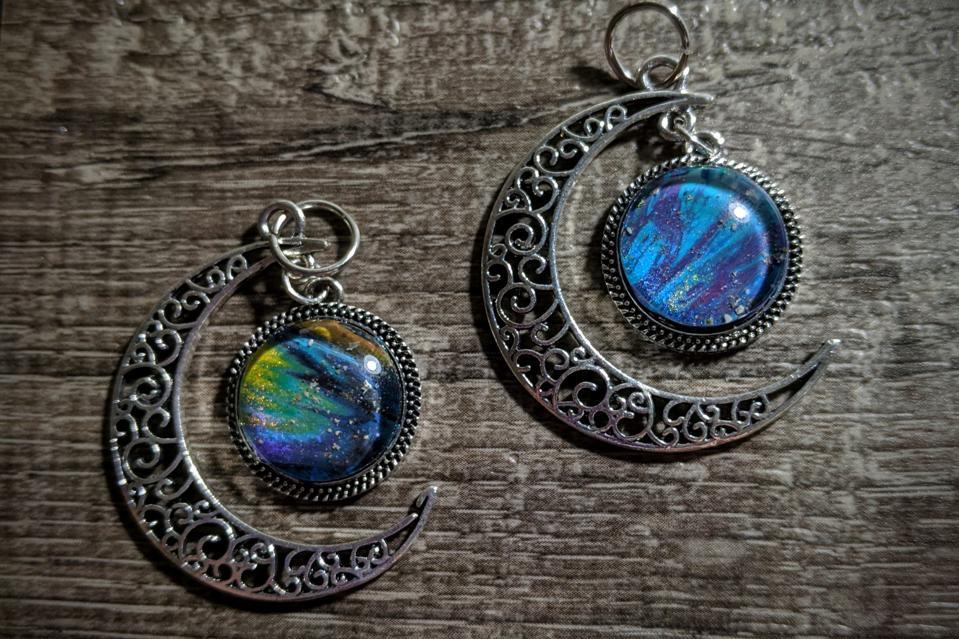 Two half-moon pendants made by Dee Ketelsen.