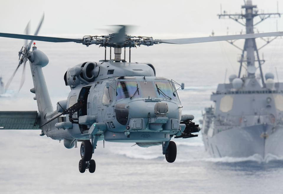MH-60R in Pacific Ocean prepares to land onboard carrier USS John C. Stennis