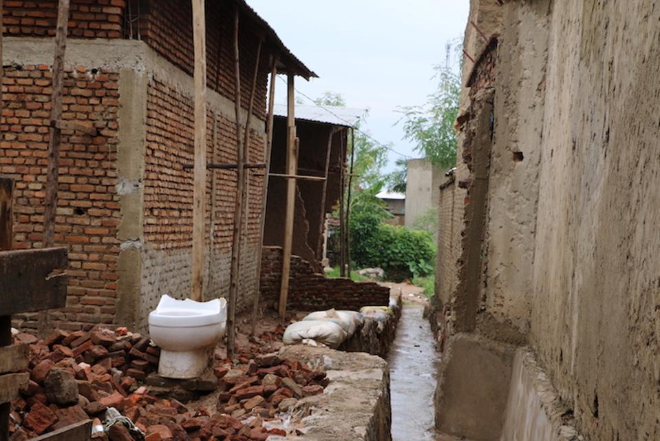 Houses made of mud bricks virtually melted in Burundi's heavy rains.