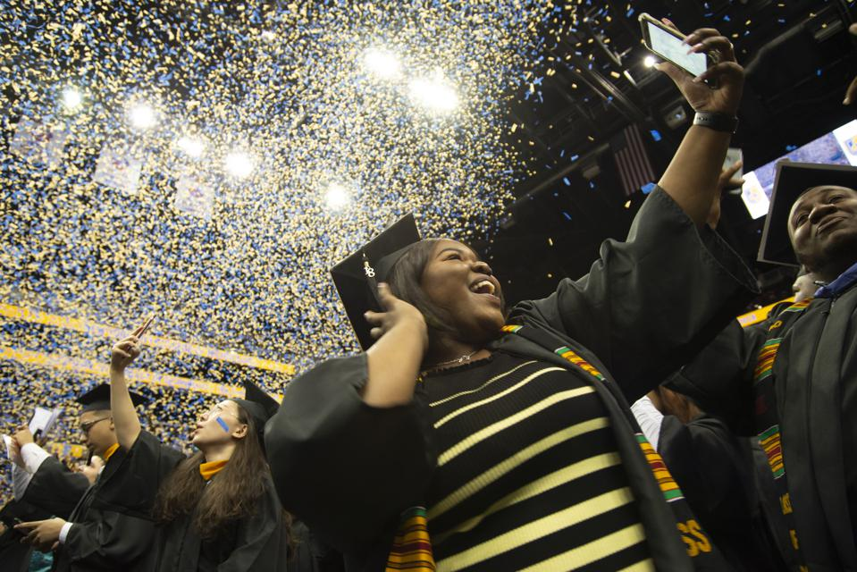 photo of a young woman celebrating her graduation by taking a selfie