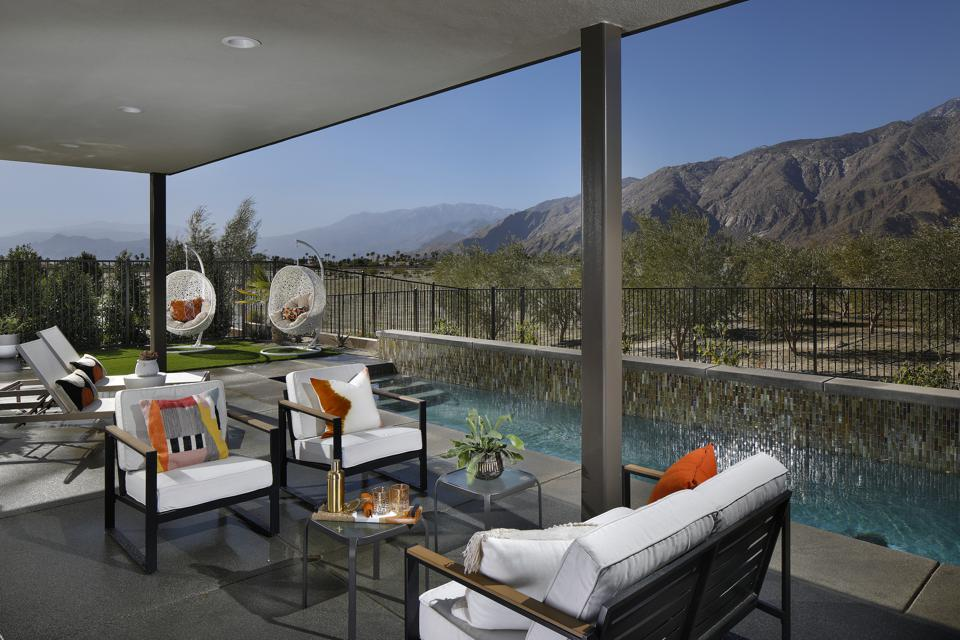 The MCM-inspired homes look out on olive and citrus groves rather than a golf course.