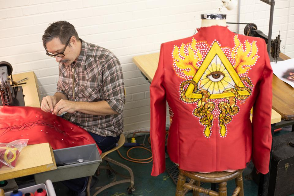 Jerry Lee Atwood creating red silk suit for Lil Nas X