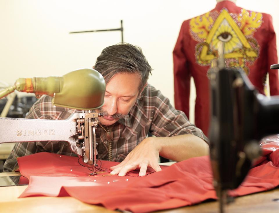 Jerry Lee Atwood is an Indianapolis-based designer shown here working on red silk suit for Lil Nas X.